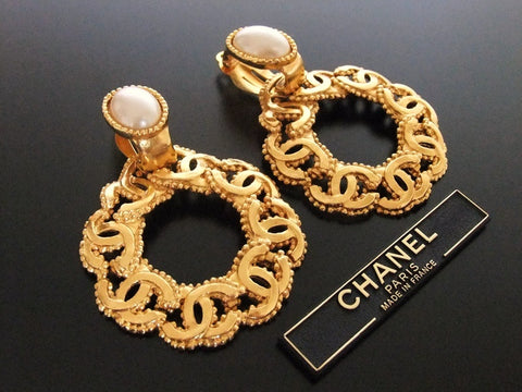 Authentic vintage Chanel earrings pearl swing gold CC hoop dangle