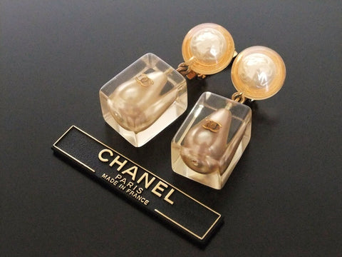 Authentic vintage Chanel earrings gold CC pearl clear swing