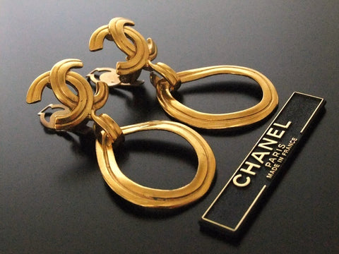 Authentic vintage Chanel earrings gold CC swing hoop large