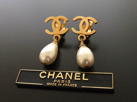 Authentic vintage Chanel earrings gold CC swing pearl drop dangle