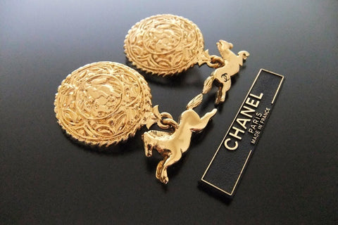 Authentic vintage Chanel earrings gold CC swing horse