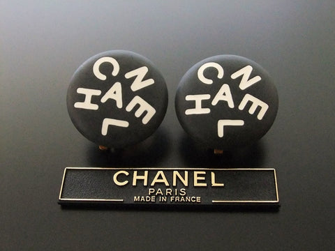 Authentic vintage Chanel earrings white logo black round