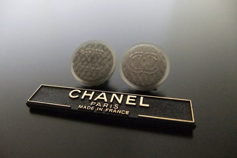 Authentic vintage Chanel earrings CC rubber