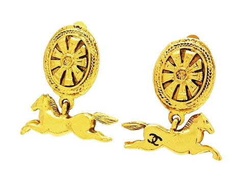 Authentic vintage Chanel earrings CC logo swing gold horse dangle