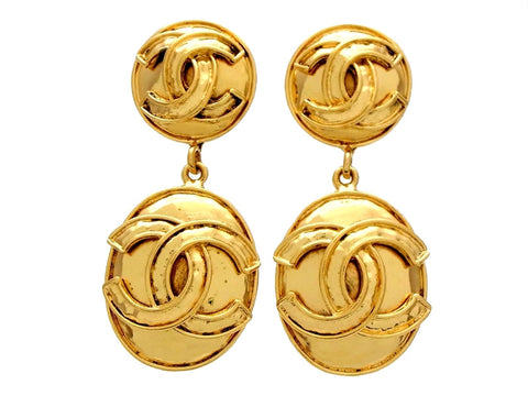 Vintage Chanel dangling earrings CC logo round