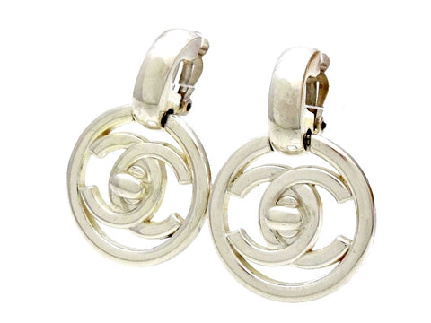 Vintage Chanel earrings turnlock CC logo round dangle silver