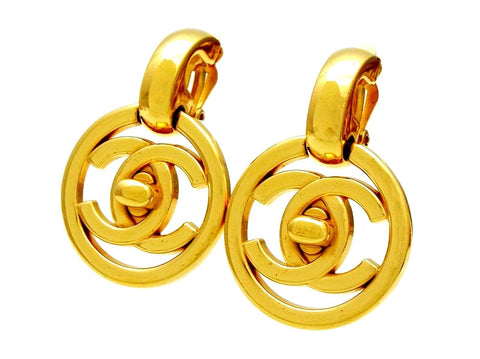 Vintage Chanel earrings turnlock CC logo round dangle