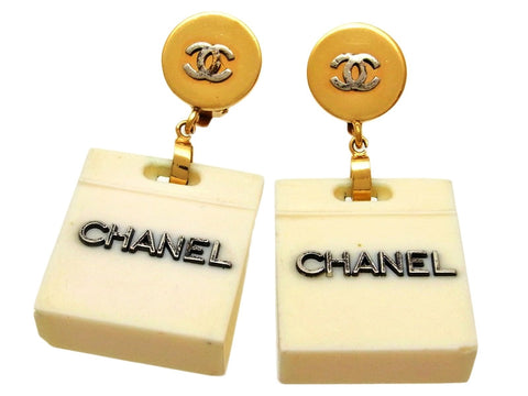 Vintage Chanel earrings CC logo white bag dangle
