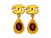 Vintage Chanel earrings CC logo red stone dangle