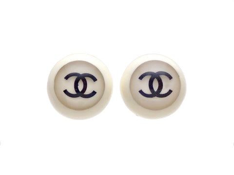 Authentic vintage Chanel earrings plastic white round black double C