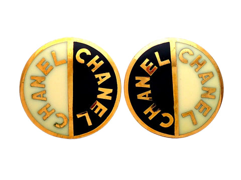 Authentic vintage Chanel earrings Black White Letter Logo Round