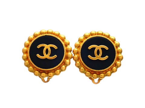Authentic vintage Chanel earrings black and gold round CC logo