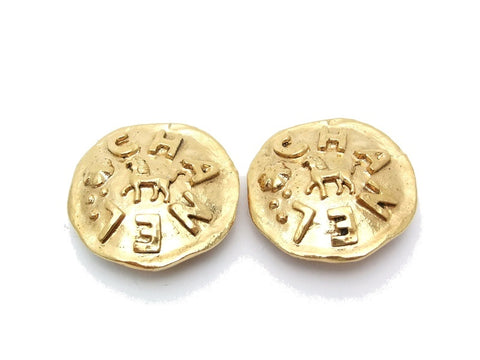 Authentic vintage Chanel earrings gold logo horse round