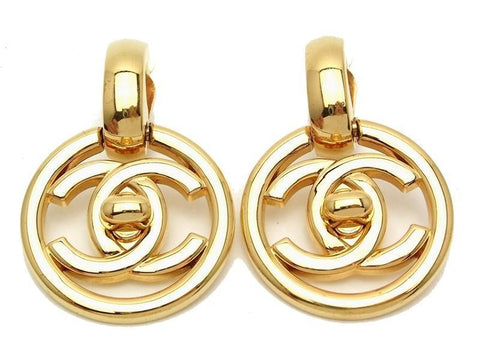 Authentic vintage Chanel earrings swing gold turnlock CC dangle