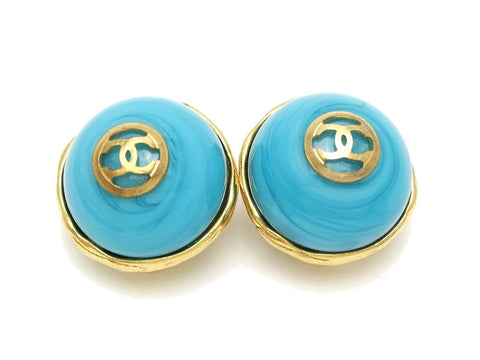 Authentic vintage Chanel earrings gold CC light blue glass stone