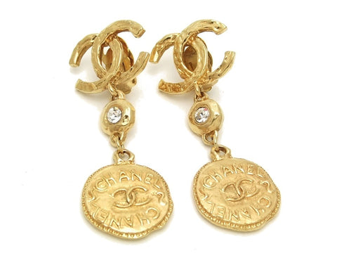 Authentic vintage Chanel earrings gold CC rhinestone medal dangle