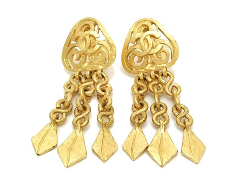 Authentic vintage Chanel earrings gold CC swing chain leaf dangle