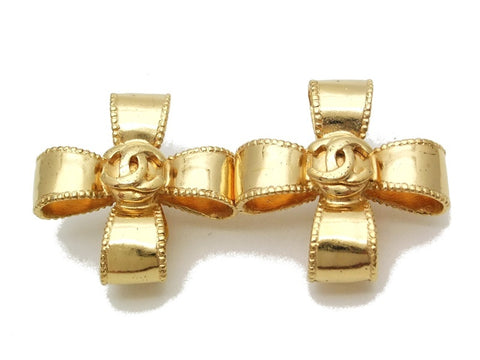 Authentic vintage Chanel earrings gold CC cross ribbon