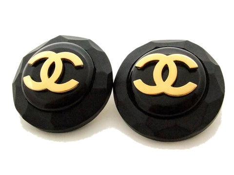 Authentic vintage Chanel earrings gold CC black plastic round clip on