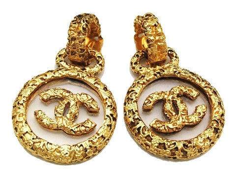 Authentic vintage Chanel earrings swing gold CC clear plastic dangle