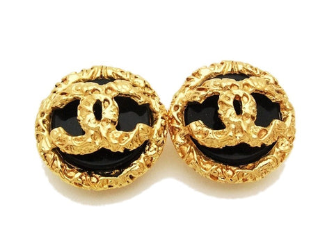 Authentic vintage Chanel earrings gold CC black plastic stone round