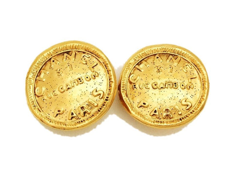 Authentic vintage Chanel earrings gold rue cambon logo medal round