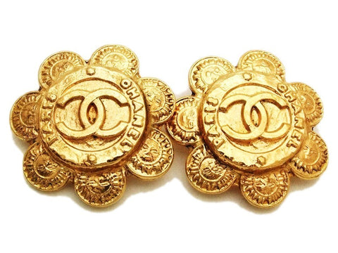 Authentic vintage Chanel earrings gold cc logo sun round clip on