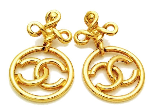 Authentic vintage Chanel earrings swing gold CC hoop dangle large
