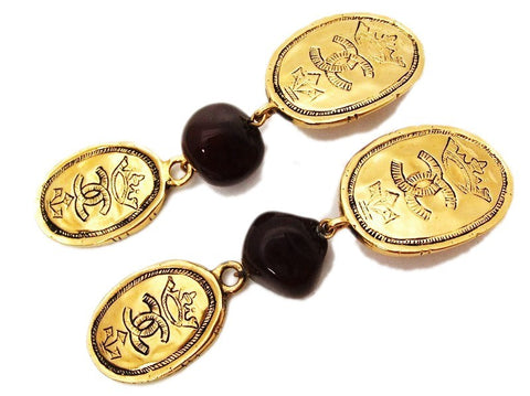 Authentic vintage Chanel earrings gold CC medal red glass stone dangle
