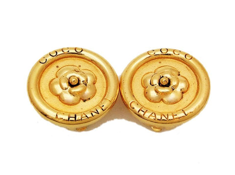 Authentic vintage Chanel earrings gold logo camellia button round