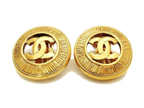Authentic vintage Chanel earrings gold CC round real clip on