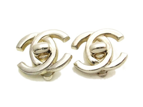 Authentic vintage Chanel earrings silver turnlock CC clip on