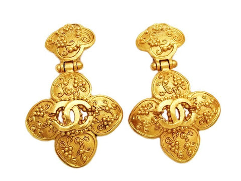 Authentic vintage Chanel earrings swing gold CC flower dangle real