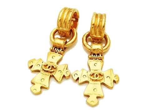 Authentic vintage Chanel earrings swing gold cc logo cross dangle