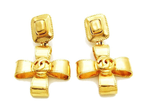 Authentic vintage Chanel earrings gold CC logo cross dangle real clip
