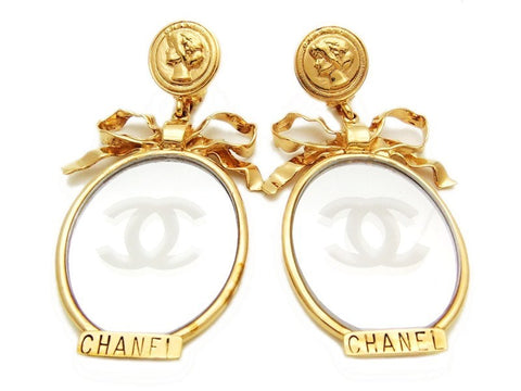 Authentic vintage Chanel earrings CC mirror COCO medal ribbon dangle
