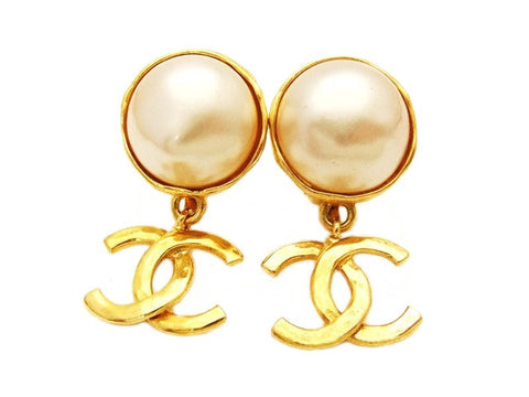 Authentic vintage Chanel earrings white pearl swing CC logo dangle