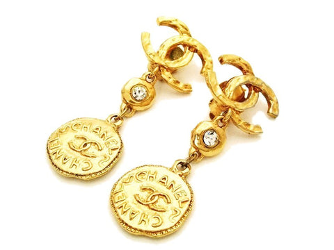 Authentic vintage Chanel earrings gold CC logo rhinestone medal dangle