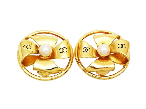 Authentic vintage Chanel earrings gold pinwheel CC logo pearl round