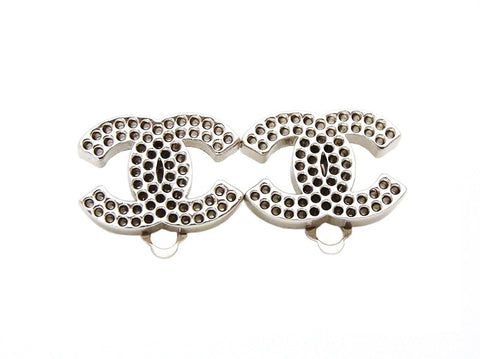 Authentic vintage Chanel earrings silver CC logo full of holes small