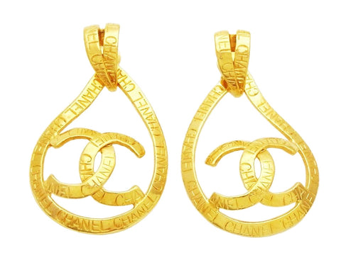 Authentic vintage Chanel earrings gold CC logo ribbon hoop dangle