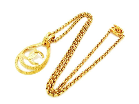 Authentic vintage Chanel necklace chain gold logo ribbon CC pendant