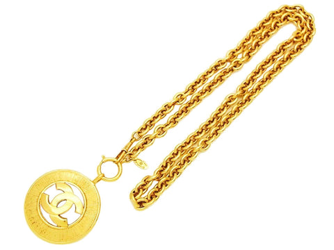 Authentic vintage Chanel necklace CC logo round pendant gold chain
