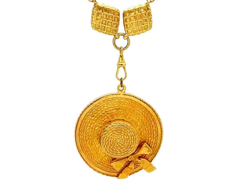 Vintage Chanel necklace straw hat