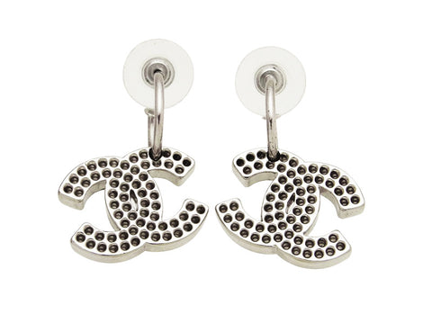 Vintage Chanel stud earrings punched CC logo dangle