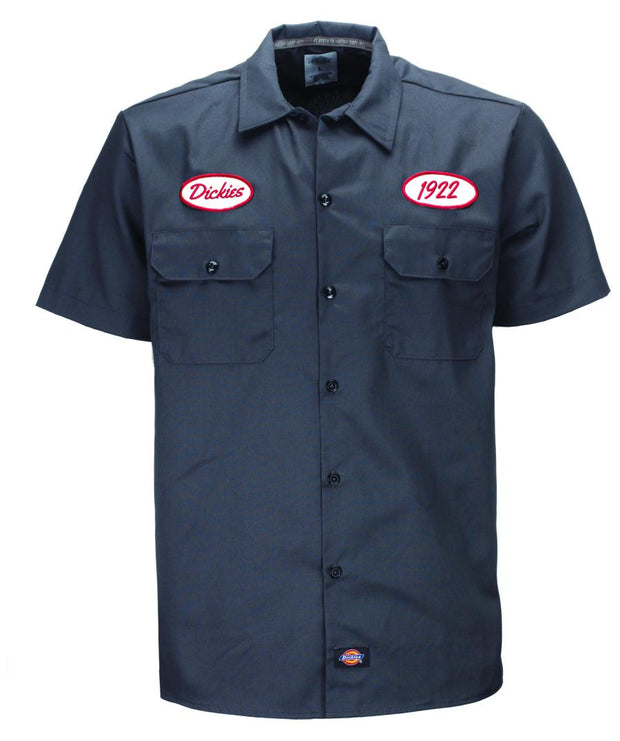 Blue short sleeve mechanics shirt from Dickies Workwear range. This shirt has a few classic old school patches on the front.