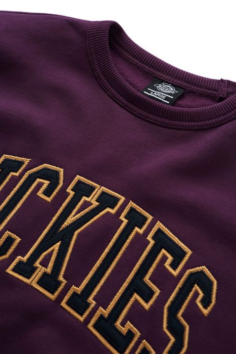 Purple college style sweatshirt with yellow Dickies logo.