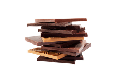 Stack of handcrafted small batch milk chocolate bars, dark chocolate bars, and white chocolate bars