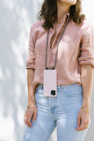 Basic phone case with adjustable crossbody phone cord that you can easily click on and off.