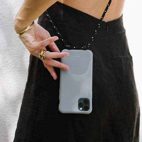 Phone case with removable cord. Wearable phone accessories. phone leash. Phone case with cord. Phone lanyard. Smartphone chains. Pearl phone rope. Handykette. Sydney. biodegradable phone case. Corded phone case. Customise your phone. Melbourne. Modular cases. Mobile ropes. Phone rope. Phone necklace